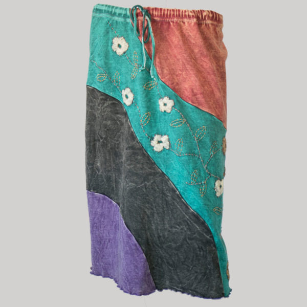 Gypsy skirt with asymmetrical printed panel patches stone wash front