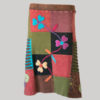 Gypsy rib skirt with asymmetrical razor cut patches and hand work front