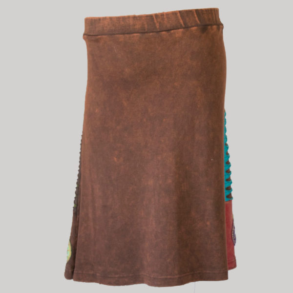 Gypsy rib skirt with asymmetrical razor cut patches and hand work back