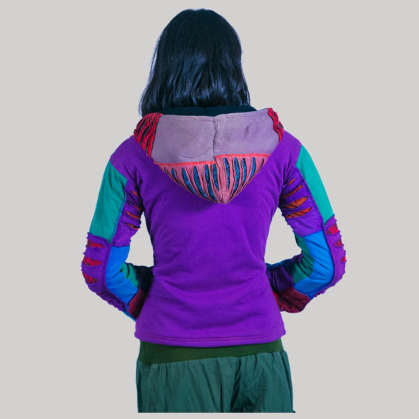 Women's jacket with asymmetrical razor cut patches