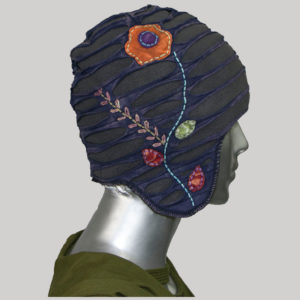 Ear-flap cap with flower hand work