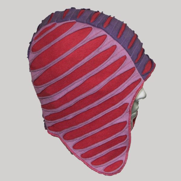 Ear-flap cap with multiple colored jersey