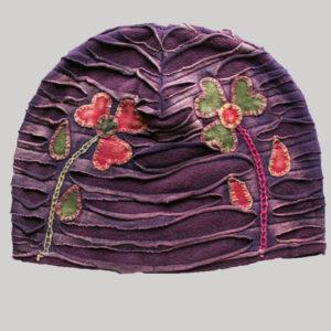 Symmetrical razor cut flower hand work cap for women