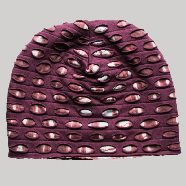 Symmetrical razor cut polar fleece cap