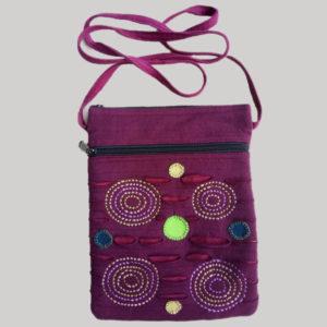 Passport bag with polka dot, embroidery, razor cut