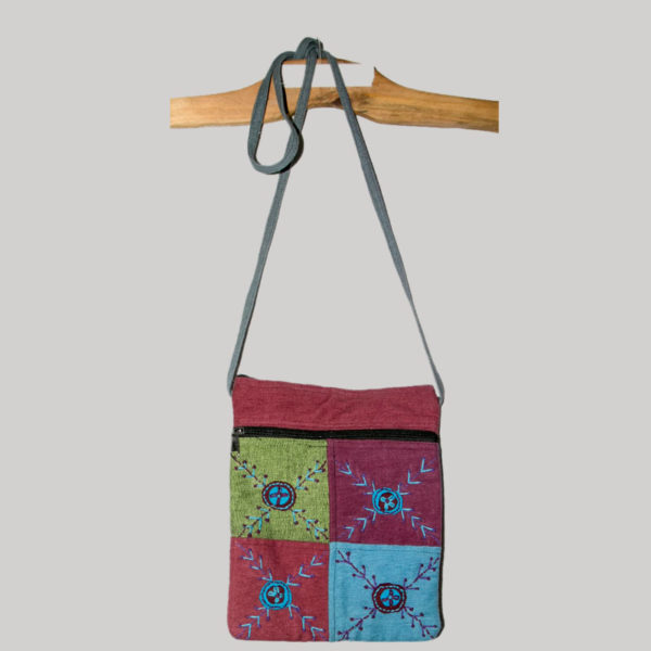 Women's passport bag patched with heavy cotton and hand work